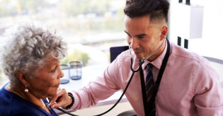 male doctor checking up his patient