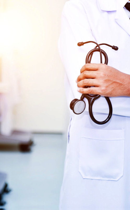 doctor's hand  holding a stetoscope