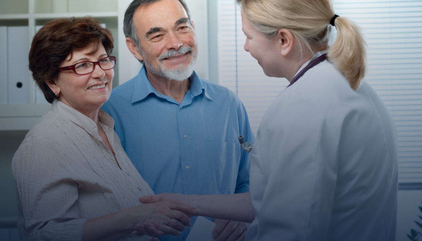 female professional doctor physician consulting old male patient