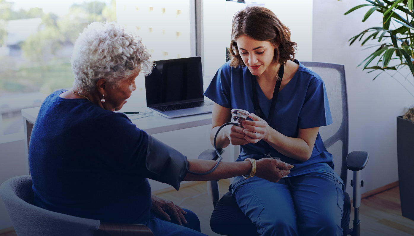 medical worker checking the blood pressure of the elderly woman