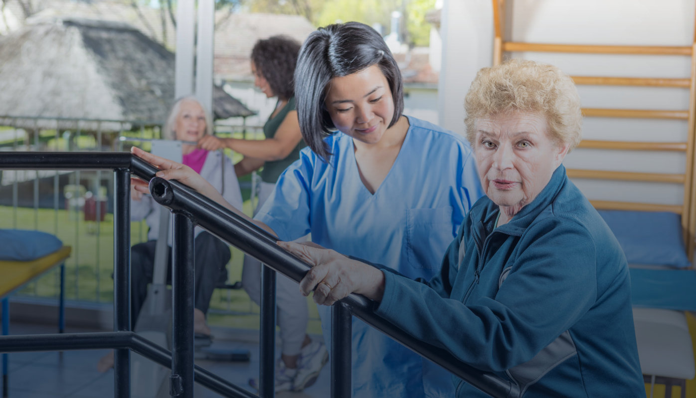 Multi racial nurses helping elder patients