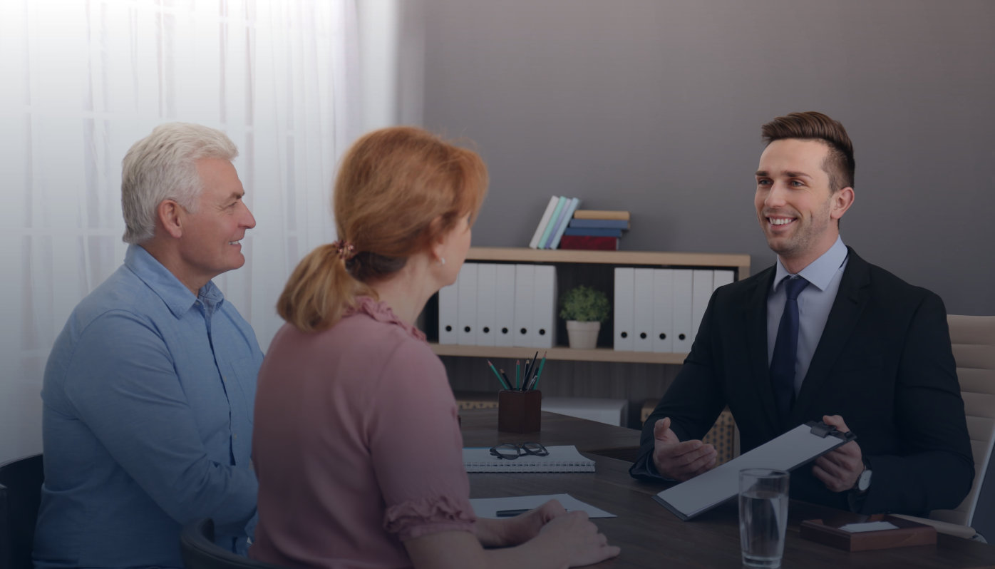 Young lawyer consulting senior couple in office