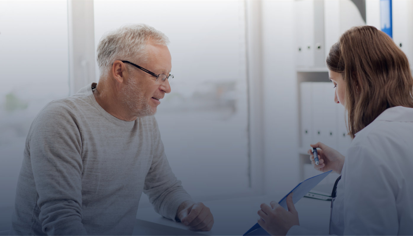senior man and doctor with clipboard meeting in medical office at hospital